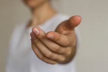 Young Woman's Hand Reaching Out