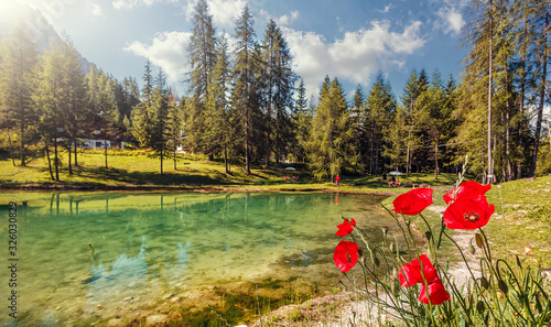 Wall mural - Beautiful natural landscape in the summer time. Italian Dolomites -view on the lake Scin. Beautiful landscape of alpine lake with crystal clear water. Amazing natural background. Dolomites Alps. Italy