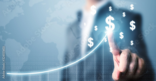Fotografía Businessman pointing dollar currency icon with a map and graph growing growth, C