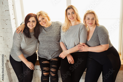 Young caucasian women in casual clothes having fun together Wallpaper Mural