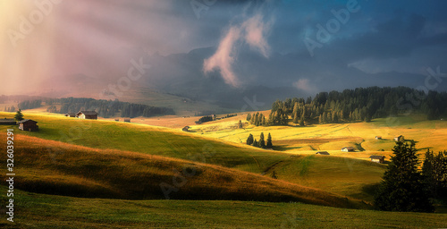 Wall mural - Incredible Nature Landscape. Awesome Dolomites Alps during sunrise. Fairytale green alpine plateau Seiser Alm (Alpe di Siusi) with overcast sky gloving sunset, Italy. Popular travel destination.