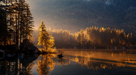 Fototapeta Vintage Wonderful Colorful Sunset at Hintersee Lake in Bavarian Alps. Awesome Alpine Highlands during sunrise. Amazing Autumn Natural Background. Incredible Nature Landscape. Beautiful locations of the World