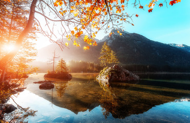 Fototapeta Rzeki i Jeziora Amazing sunny landscape at famouse lake Hintersee. popular travel and hiking destination. Wonderful Summer Scene with Calm Fairytale Lake under sunlight. Autumn natural scene. nature Background.