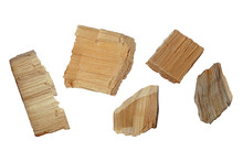 Set Of Wood Chips On A White Background. Top View Of A Group Of Wood Chips On A White Background. Oak Wood Chips. Parts Of Pine Or Oak Wood Chips On A White Background, Top View.