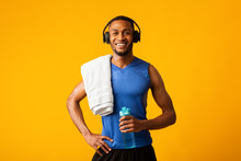 Healthy Black Sports Guy Holding Bottle Of Water