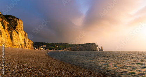 Scenic landscape of Etretat cliffs, falaise d'Aval, at dusk or sunset, natural landmark of Normandy Coast, France Wallpaper Mural