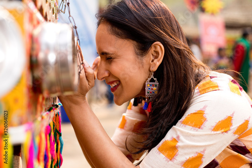 Women looking into bioscope at Surajkund Mela Canvas Print