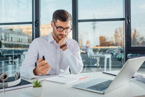 Fototapeta professional translator in eyeglasses working online with laptop obraz