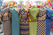 Leinwanddruck Bild Six colorful African fabrics presented as dresses on mannequins in Mozambique