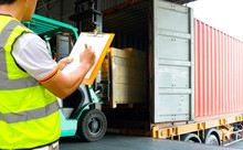 Warehouse Worker Courier Hand Holding Clipboard Inspecting Load Shipment Goods, Truck Docking At Warehouse, Road Freight Industry Logistics
