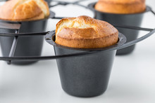 A Close Up Of A Pan Of Popovers Fresh Out Of The Oven.