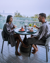 Breakfast On Balcony With A Look Over Pattaya Thailand, Couple Having Breakfast On Balcony With Seaview