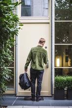 Male Entrepreneur Unlocking Door