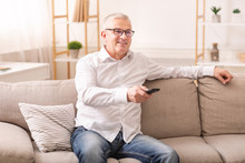 Elderly Man Watching Tv Sittin...