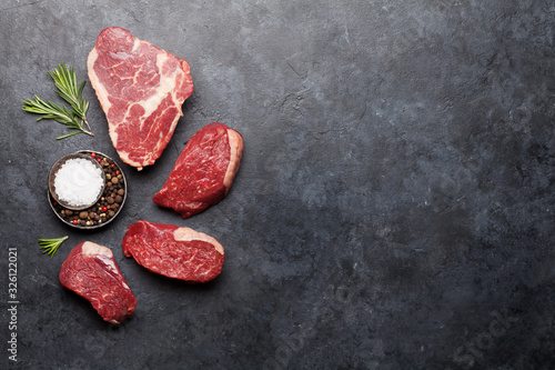 Fotografía Variety of raw beef steaks