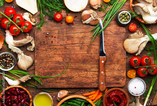 Food cooking background, ingredients for preparation vegan dishes, vegetables, roots, spices, mushrooms and herbs Fotobehang