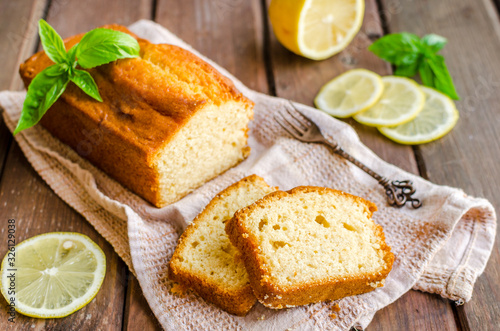Lemon pound cake on rustic wooden background with lemon. Poster Mural XXL