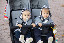 Adorable Twin Baby Girls Sitti...