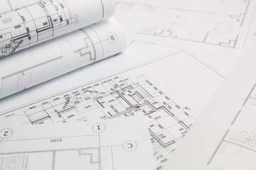 Paper architectural drawings and blueprints