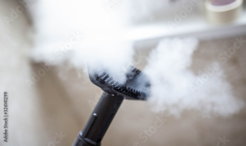 steam cleaner for cleaning the house, steam erupts from the brush Canvas Print