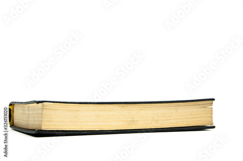 Closed book on the table .. Bible. On a white background. Canvas-taulu