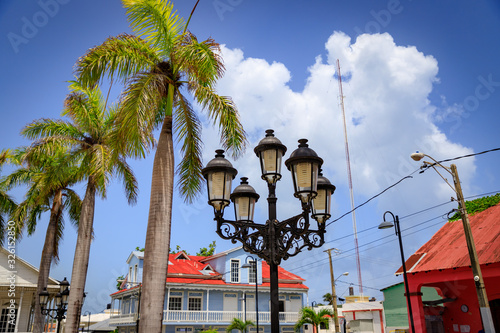 Fototapeta Historical street lamps in colonial style and palm trees in the old town of Puerto Plata, Dominican Republic, Caribbean
