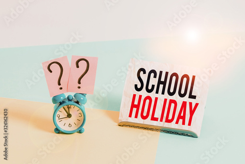 Photo Writing note showing School Holiday