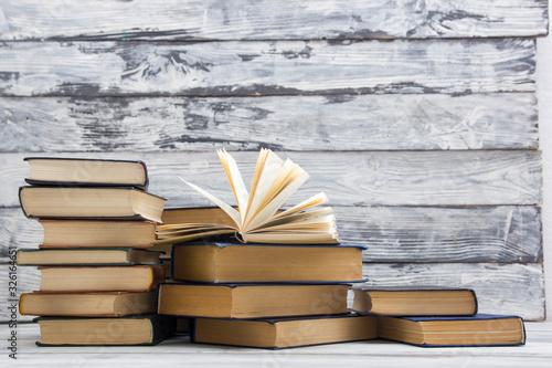 Fényképezés Open book, hardback books on wooden table