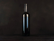 Bottle With Red Wine Stands O...