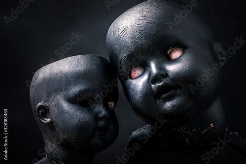 Foto Pair of creepy dolls in the dark