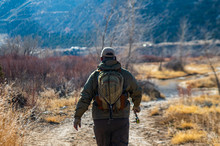 A Man Fly Fishing On The San Jaun River In The Winter.