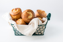 Close Up Of A Basket Of Freshly Baked Popovers Ready For Sharing.