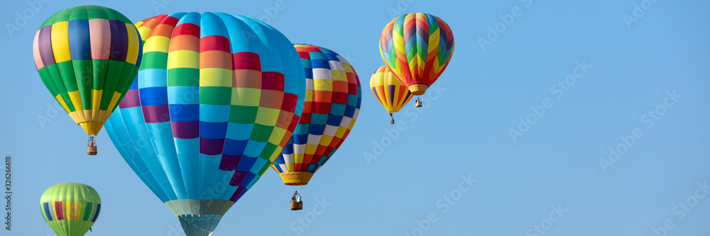 Fototapeta colorful hot air balloons in blue sky with copy space