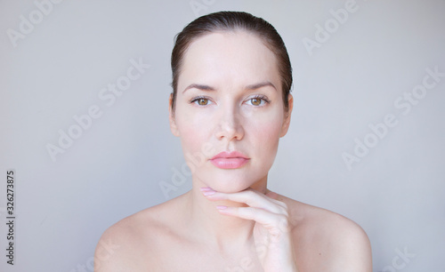Photo portrait of a woman with facial asymmetry and a squeezed upper eyelid