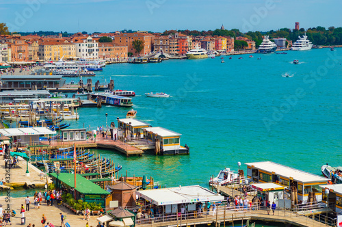 Fototapety, obrazy: Venice, Italy - CIRCA 2013: A shot of Piazza San Marco ferry terminal in Venice at a bright summer day, with crowded tourists