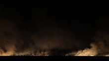 Fire And Smoke Disaster In The Field Near The Railway. Train Rides Through The Fire. Time-lapse.
