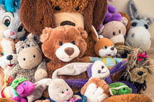 Lot Of Soft Plush Toys Sits On Floor In The Children's Room
