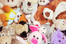 Many Soft Plush Toys Lie On Floor In The Children's Room