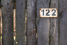 Number 122 On A Wooden Fence