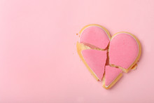 Broken Heart Shaped Cookie On Pink Background, Top View With Space For Text. Relationship Problems Concept