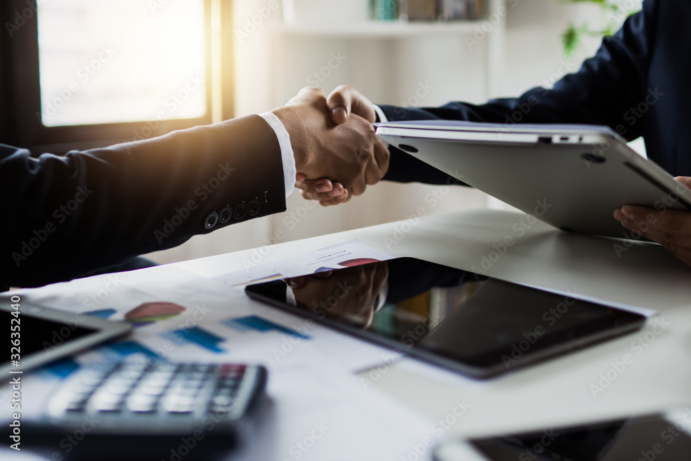 Fototapeta successful negotiate and handshake concept, two businessman shake hand with partner to celebration partnership and teamwork, business deal.