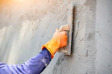 Mason Plastering The Concrete ...