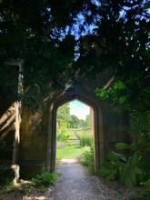 English Country Garden, Secret Garden Through An Archway On Castle Grounds