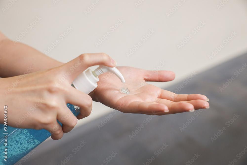 Fototapeta Woman Hand Pump Alcohol Gel in order to Kill Germs