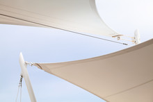 White Awnings In Sails Shape Under Bright Blue Sky