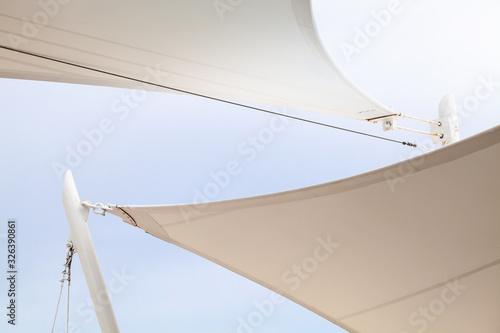 Fotografie, Obraz White awnings in sails shape under bright blue sky