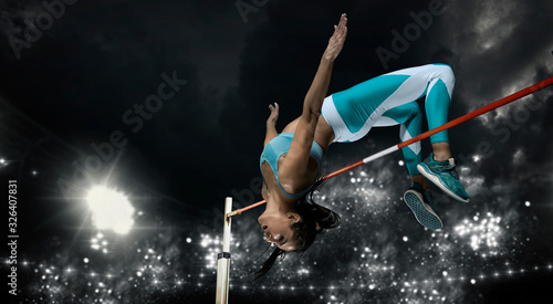 Woman in action of high jump. Sports banner Canvas Print