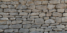 Old Grey Stone Wall Made Of La...