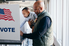 Father And Son Voting On Elect...
