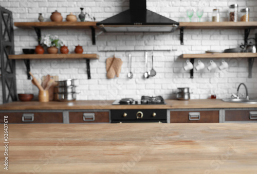 Empty wooden table in beautiful kitchen. Interior design - fototapety na wymiar